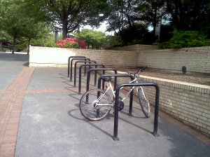 After I run those bike racks, can I make the leap to the next wall? I'll try it.