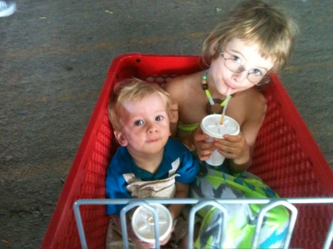 Indilea and Taos drinking batidos in a shopping cart